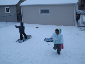 Snow surfing with his buddy from next door.