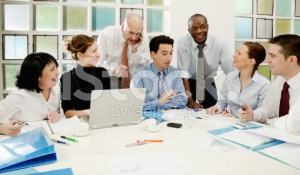 stock-photo-15445389-business-team-at-work-